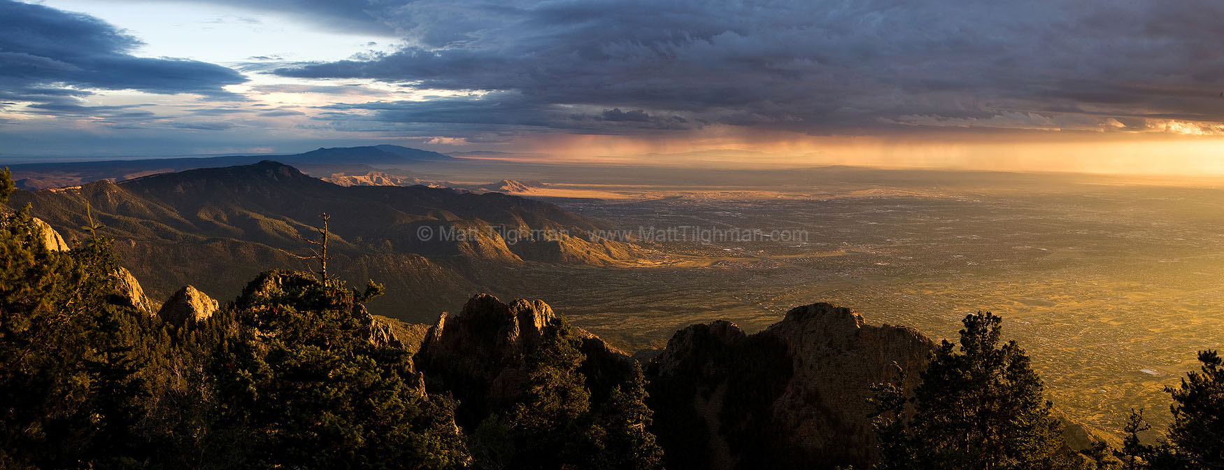 Fine art stock photograph from Albuquerque, New Mexico. A beautiful sunset clashes with a powerful monsoon storm over Albuquerque,, as seen from atop the Sandia Mountains.
