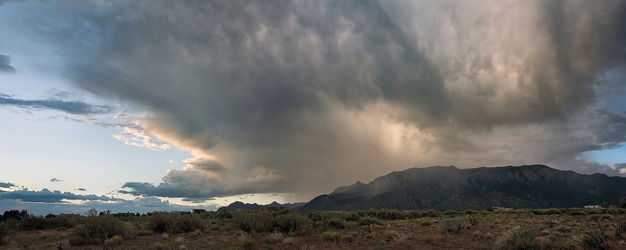 Fine art stock photograph of a supercell towering high over the Sandia Mountains of New Mexico. Large storms such as this are common in New Mexico's monsoon season.