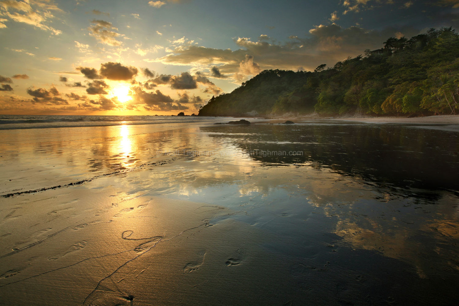 Fine art stock photograph from Manuel Antonio National Park, in Costa Rica. The sun sets over the beach, dense jungle, and the Pacific Ocean.