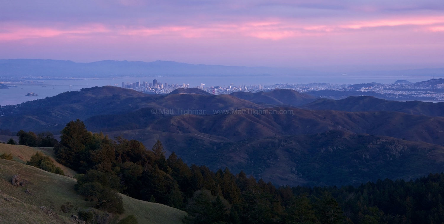Fine art stock photograph of beautiful panoramic scene of San Francisco at sunset, as seen from Mount Tamalpais, high up in the Golden Gate National Recreation Area.