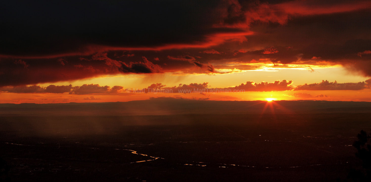 Fine art stock photograph of a summer monsoon outside Albuquerque, from atop the Sandia Peak at sunset.