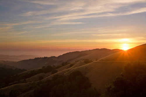 Fine art stock photograph of a beautiful summer sunset in Russian Ridge Open Space, amidst the hillsides of the Santa Cruz Mountains in California's Bay Area.