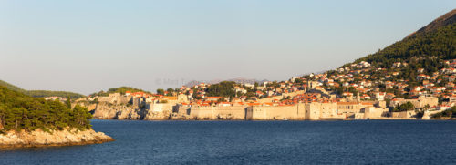 Fine art stock photograph from Croatia's Dalmatian Coast. Looking at Dubrovnik from the sea, almost the entire city is obscured by its massive walls.