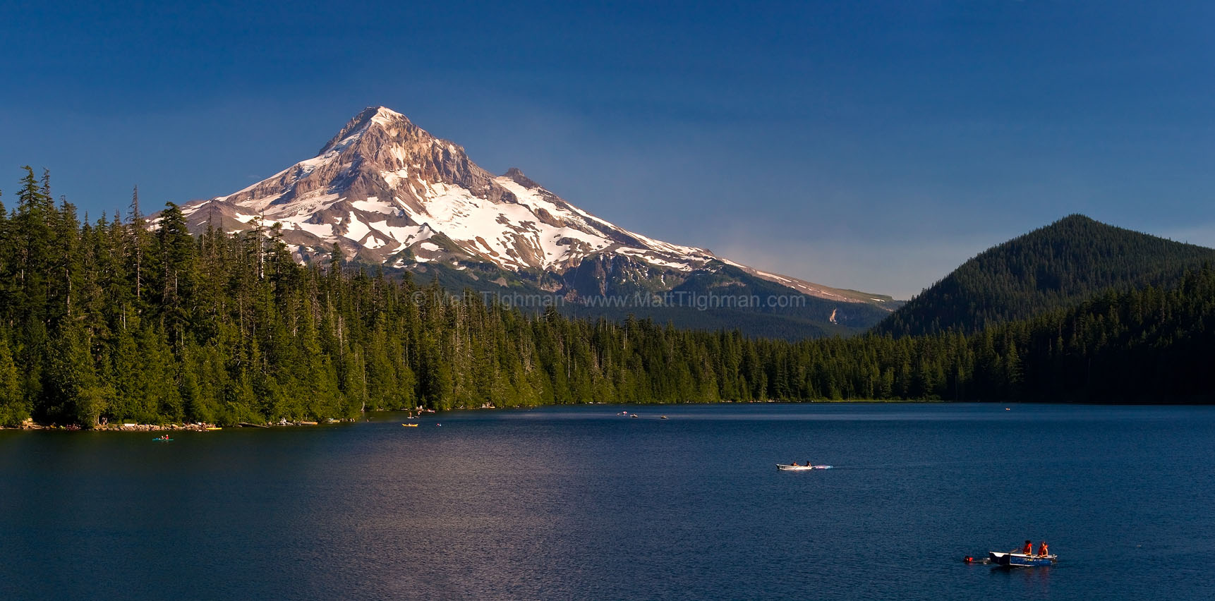 Fine art stock landscape photograph of Lost Lake, Oregon, and Mount Hood. On a hot summer day, the locals come en masse to enjoy the beautiful mountain lake.