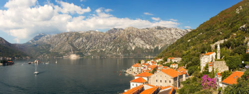 Fine art stock landscape photograph from Perast, Montenegro. From high up the bell tower, the panoramic vista of the Dinaric Alps and Kotor Bay is sublime.