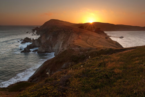 Fine art stock landscape photograph of sunset at Point Reyes, California. Although the foggiest place in the USA, the view from Chimney Rock was clear this day.