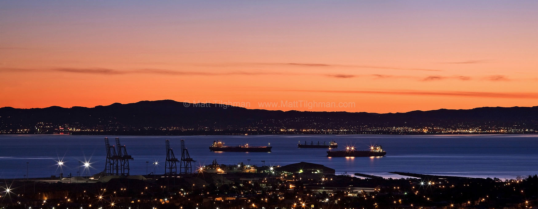 Fine art stock photograph from California's San Francisco Bay. The bay will soon be crowded with recreational boaters, but at dawn it's dominated by industry.