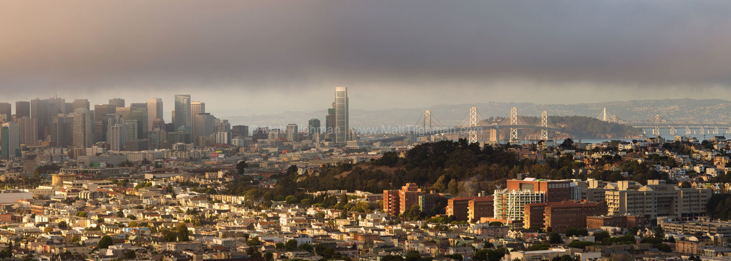 Fine art stock photograph from San Francisco. From Bernal Heights Park, you can watch the fog descend through the downtown skyline and out over the bay.