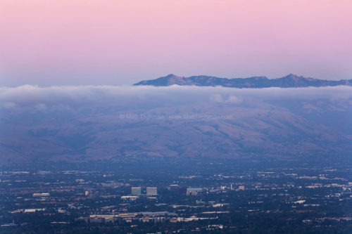 Fine art stock landscape photograph from California's Silicon Valley. Seen at dusk, the towering Diablo Range puts bustling life in the valley into perspective.