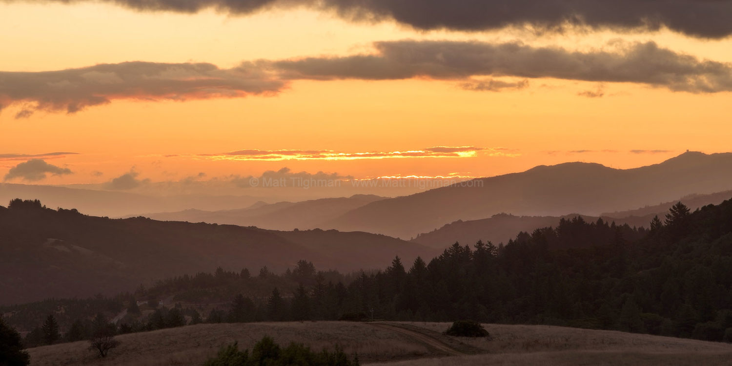 Fine art stock landscape photograph from Borel Hill, in the Bay Area's Russian Ridge Preserve. Winter skies bring clouds, finally yielding intriguing sunrises.