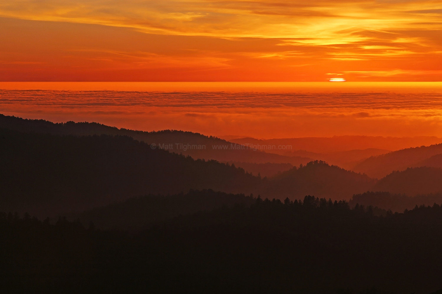 Fine art stock photograph from California's Santa Cruz Mountains. From atop Borel Hill, the sunset light seems to recede from the gentle coastal mountains.