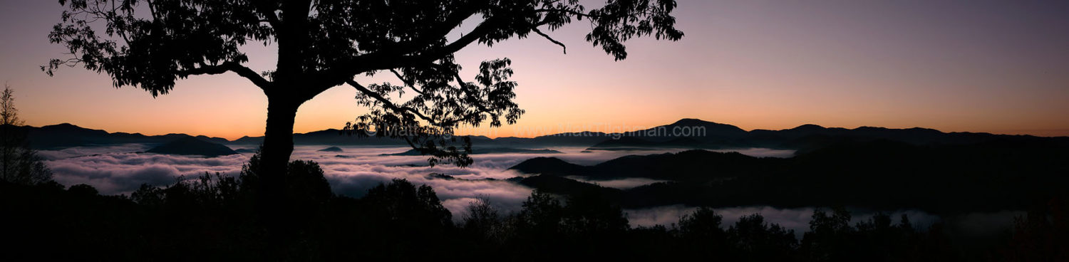 Fine art stock photograph of a beautiful, foggy Smoky Mountain sunrise, looking out over the Santeetlah Gap, in Western North Carolina.