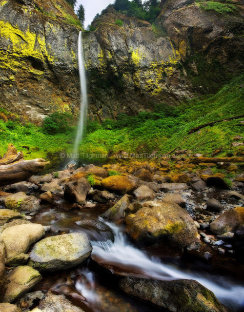 Fine art stock landscape photograph of Elowah Falls, a waterfall in Oregon's Columbia River Gorge. On this windy day, the ribbon of water took on many shapes.
