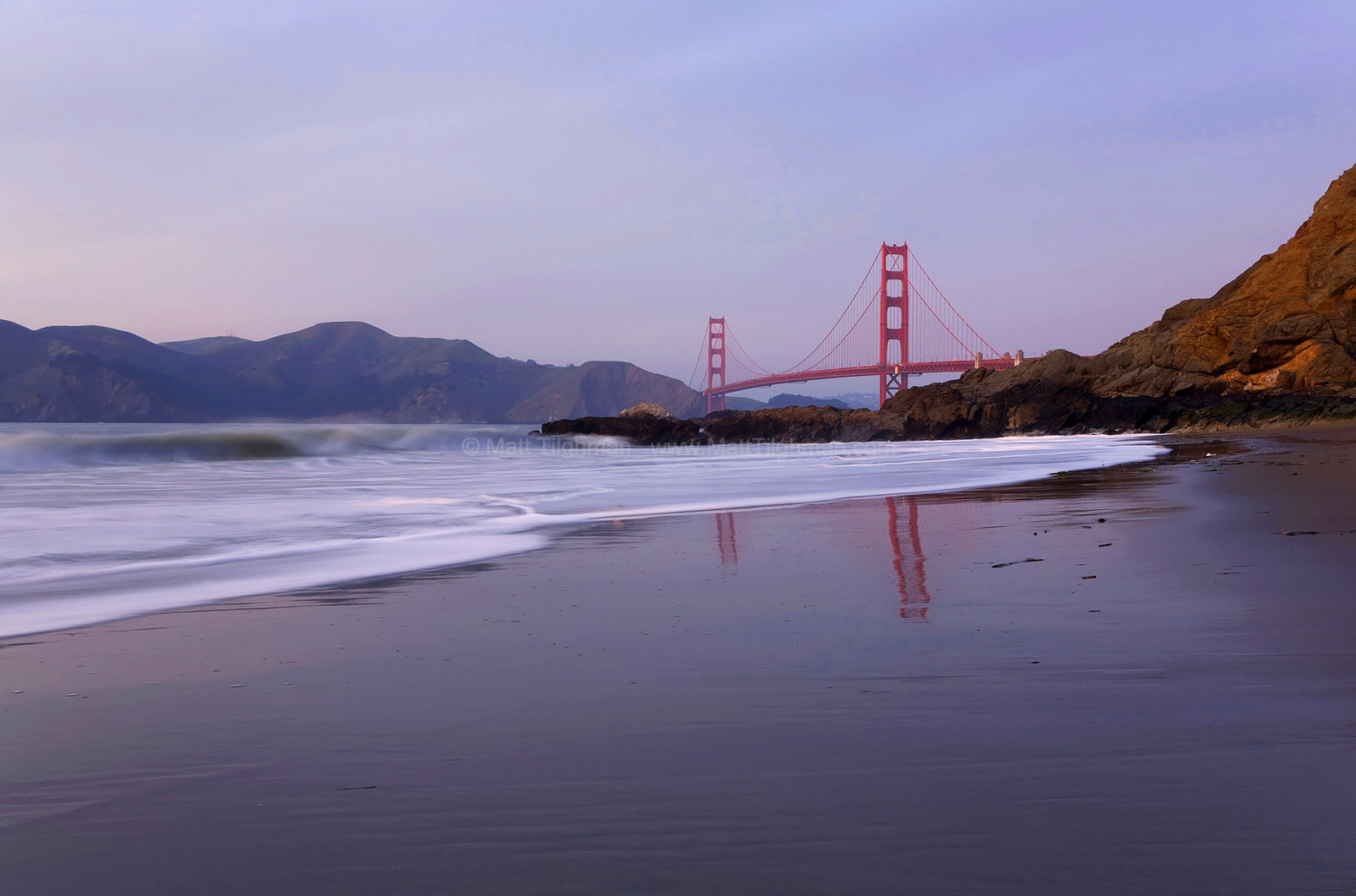 Fine art stock photograph of the Golden Gate Bridge. California's iconic bridge, seen from Baker Beach, connects San Francisco's Presidio to the Marin Headlands.