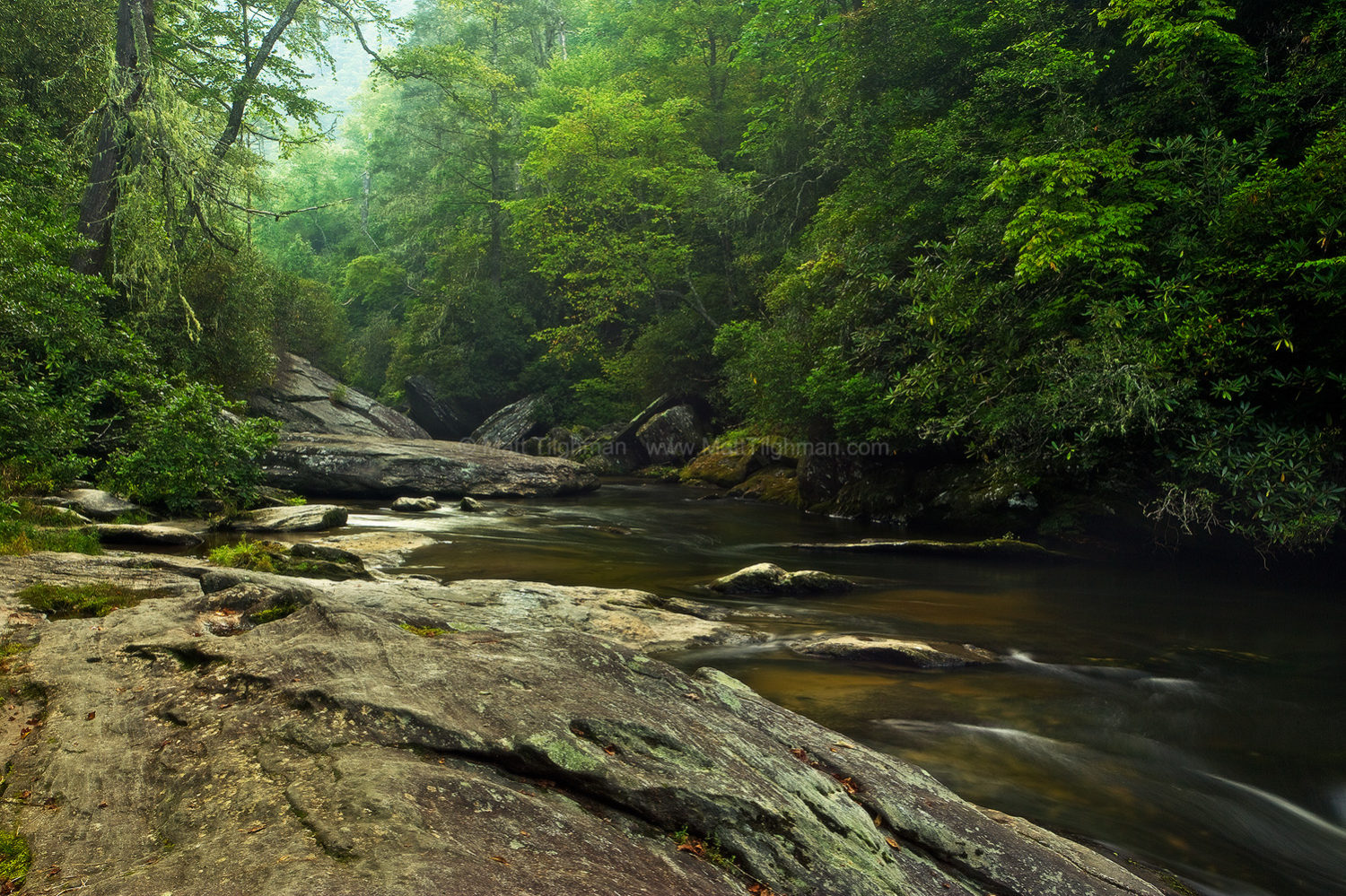 Fine art stock photograph of North Carolina's Blue Ridge Mountains at dawn. The Chattooga River cuts through ancient granite boulders in lush green forest.