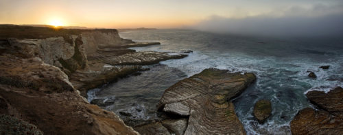 Fine art stock photograph from Panther Beach, near Santa Cruz California. The beautiful cliffs are greeted by Pacific Ocean fog, and a beautiful sunrise.