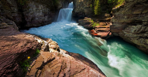 Fine art stock landscape photograph of St Mary Falls, in Glacier National Park. The beautiful turquoise blue water is silty meltwater from the glaciers above.
