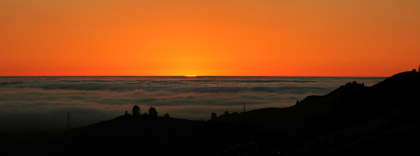 Fine art stock photograph from the Santa Cruz Mountains of California. The hills are silhouetted against a beautiful sunset, as seen from Windy Hill Open Space.