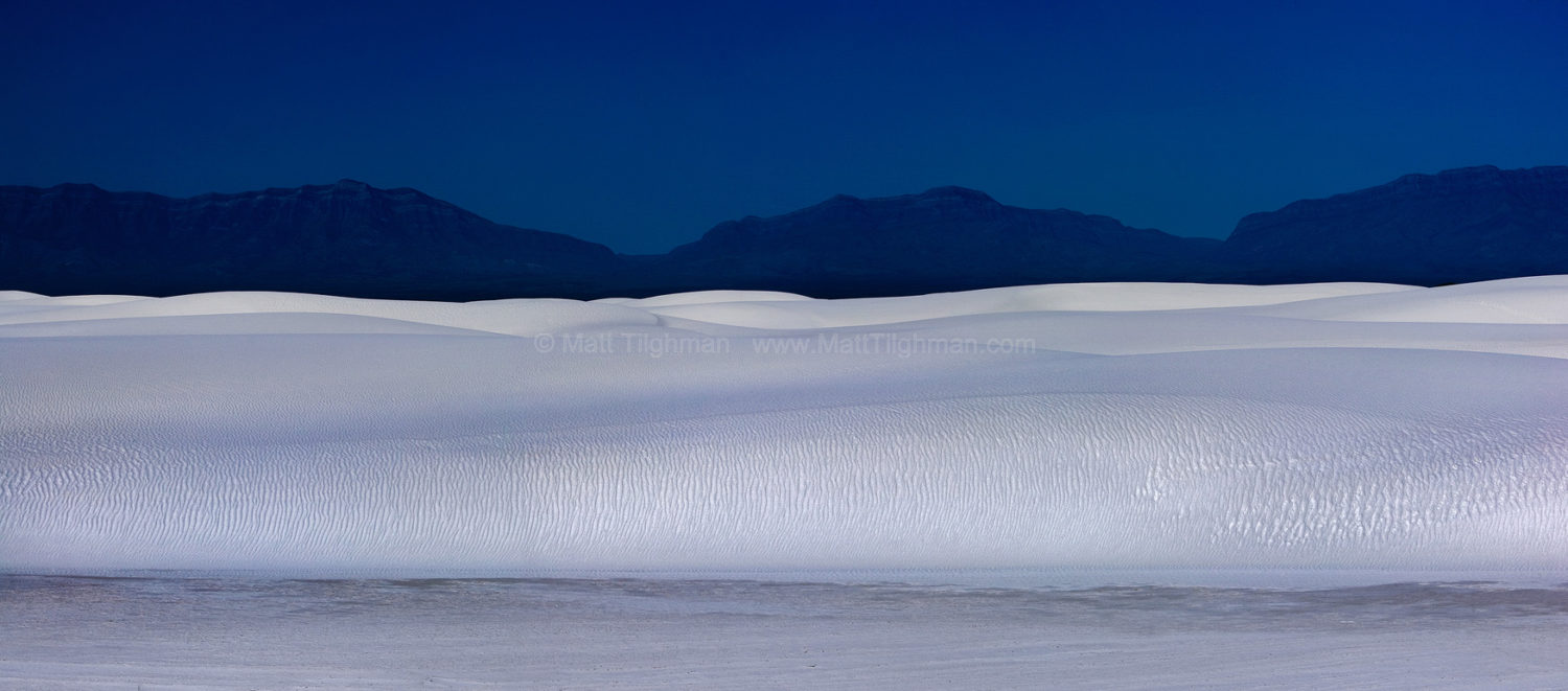 Fine art stock photograph of White Sands National Monument, in New Mexico. The wave-like white gypsum dunes are among the most beautiful landscapes on earth.