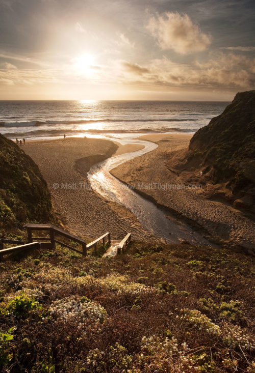 Fine art stock photograph of Martini Creek carving through the sands of Montara Beach (near Pacifica, California) at sunset, on its way to the Pacific Ocean