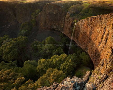 Fine art stock photograph of Phantom Falls, a season waterfall in North Table Mountain, California, plunging over volcanic cliffs at sunset.