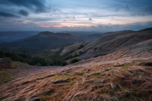 Fine art stock photograph of a cold California winter storm approaching Russian Ridge Open Space at Sunset, in the Santa Cruz Mountains.
