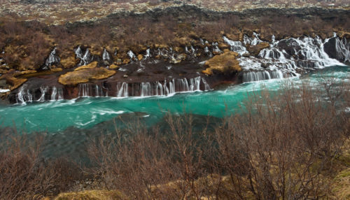 Fine art stock photograph from Hraunfossar, Iceland's famous Lava Falls, in March. The glacial melt water seeps directly from the volcanic riverbanks.
