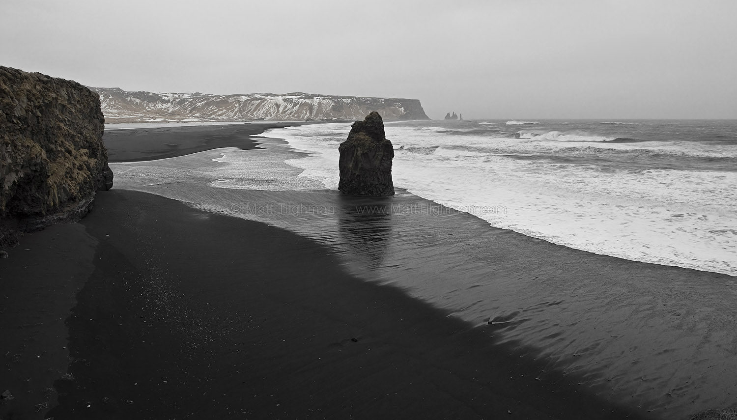 Fine art stock photograph from Iceland's Reynisfjara Beach, seen from Dyrhólaey. With its famous black sand, it takes on an ominous tone in stormy weather.