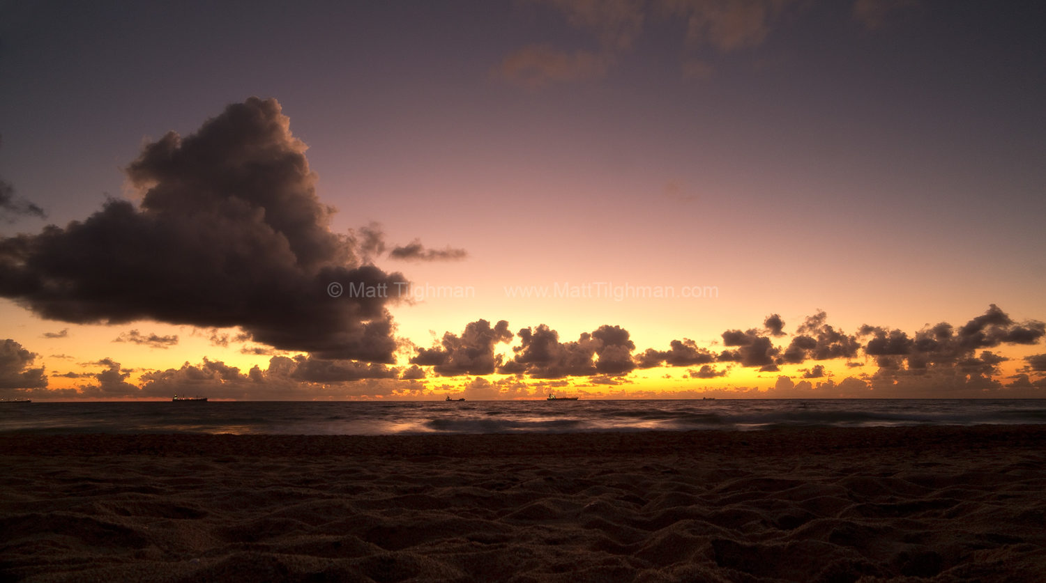 Fine art stock photograph of the South Florida coast, moments before sunrise. The tropical sky glows a deep gold, off the coast of Fort Lauderdale.