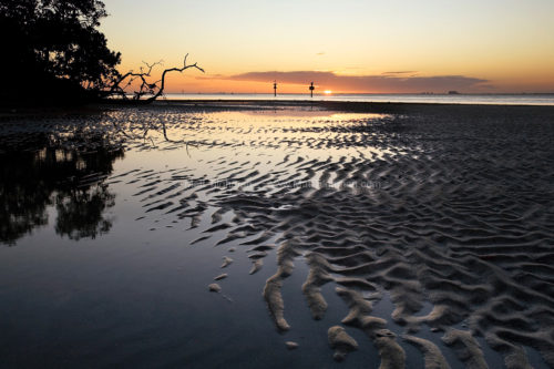 Fine art stock photograph of the Biscayne Bay, Florida, at low tide. As the sun sets over the bay, just outside of Miami, civilization feels worlds away.