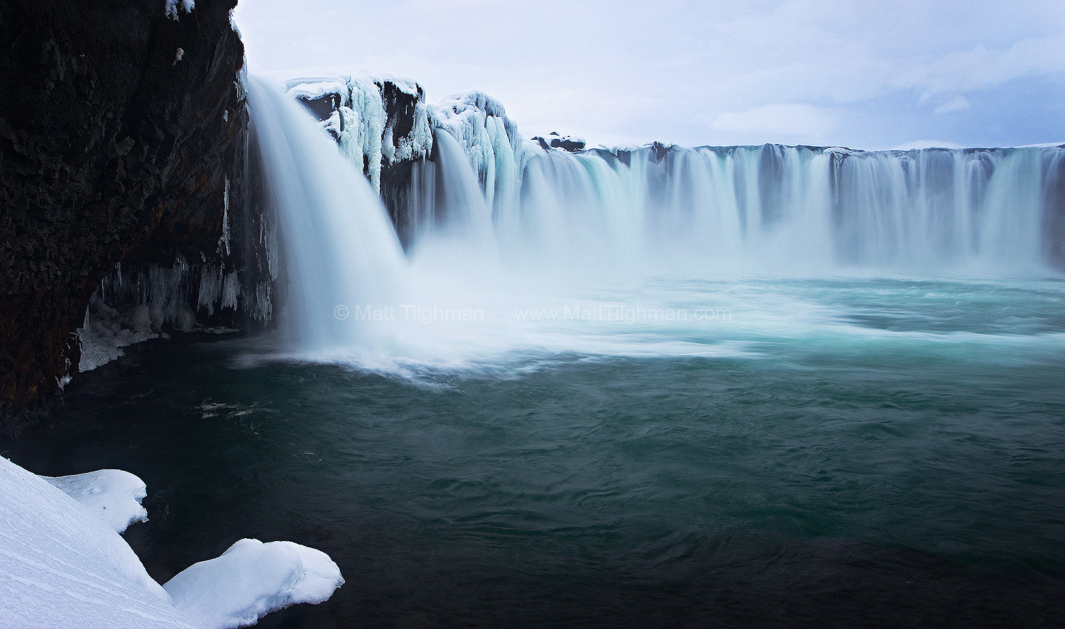 Fine art stock photograph of Godafoss, Iceland. Winter brings a beautiful fantasy-like landscape to this iconic waterfall. It also helps keep away the tourists.