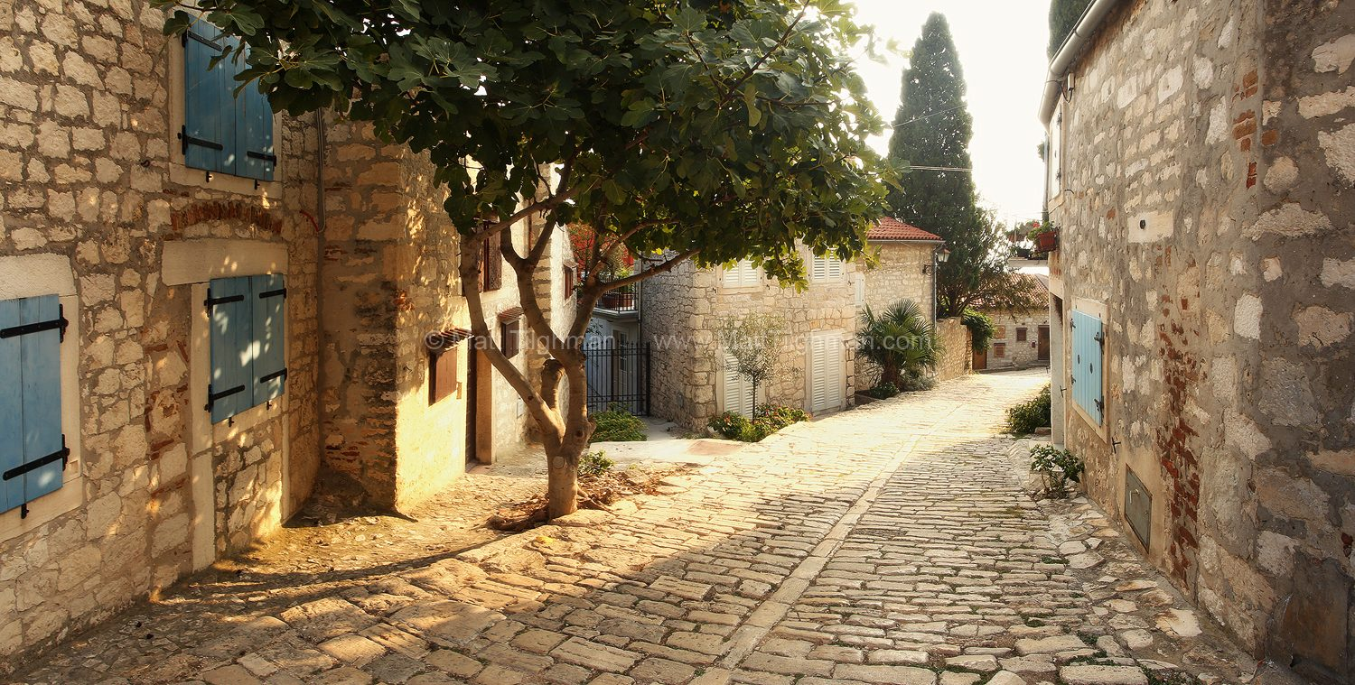 Fine art stock photograph of a peaceful alleyway in Rovinj, Croatia. The town of Rovinj is a romantic treasure along the coast of the Adriatic Sea.