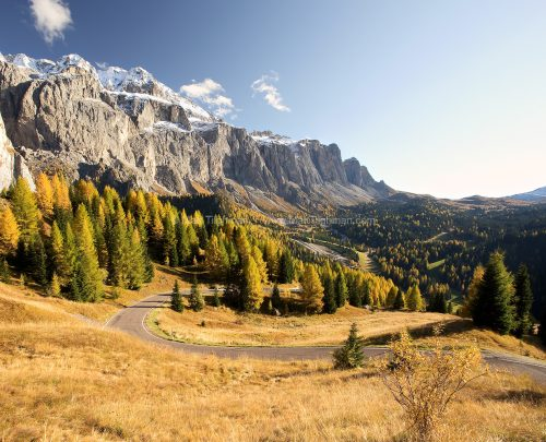 Fine art stock photograph of the mountainous Dolomite region of Northern Italy. This area's beauty peaks in autumn, when the European Larches turn bright gold.
