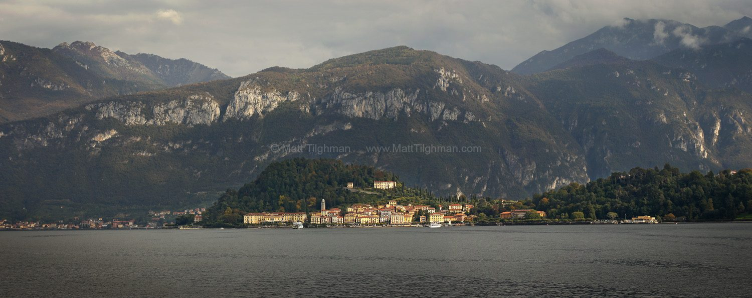 Fine art stock photograph of Bellagio, on Lake Como Italy. A brief ray of sunshine breaks through the overcase sky, bathing the ancient city in beautiful gold.